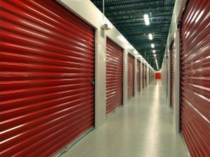 Red door storage units with hallway perspective