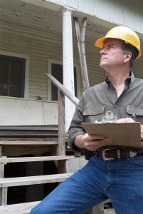 Inspector creating a home inspection report