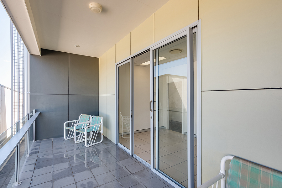 A balcony with with privacy film glass door