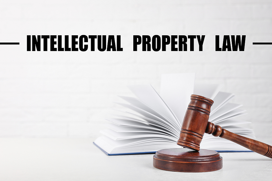 Text showing Intellectual Property Law Over Judge's Gavel And Book On Table