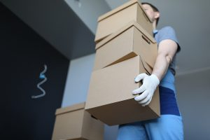 Removalists carrying boxes