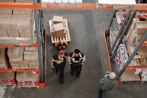 Two workers working in a 3PL Warehouse