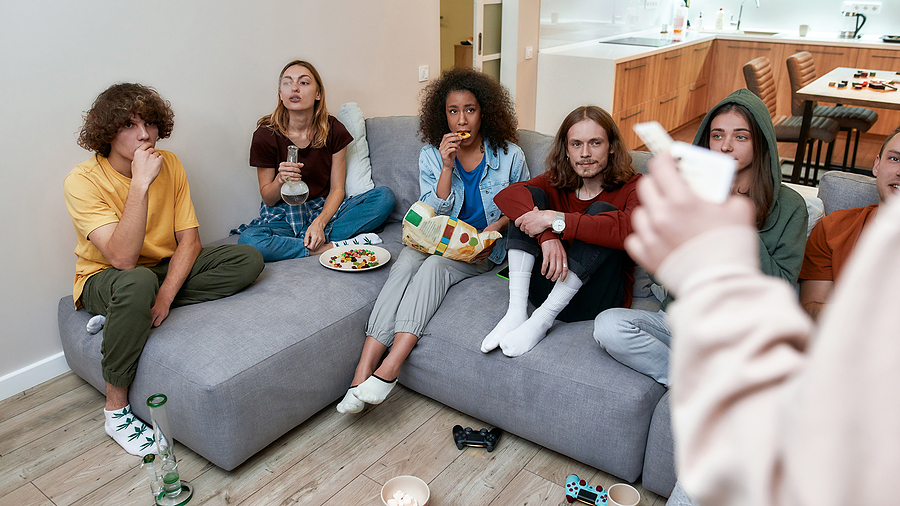 Young people in the living area using affordable bongs bought online