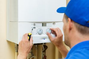 hot water plumber in Canberra installing the system